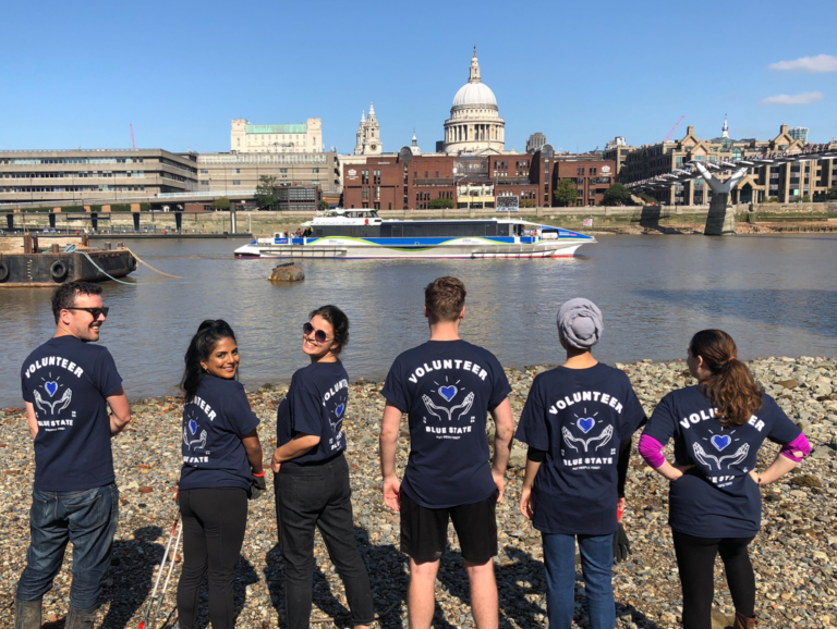 Blue State's London team posing in front of river for Volunteer day